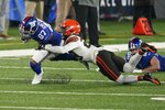 Cleveland Browns' Sheldrick Redwine (29) tackles New York Giants' Sterling Shepard (87) during the first half of an NFL football game Sunday, Dec. 20, 2020, in East Rutherford, N.J. (AP Photo/Corey Sipkin)
