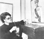 FILE - In this Oct. 18, 1981, file photo, Jehan Sadat, widow of slain Egyptian President Anwar Sadat votes near her home in Giza at a local police station in a referendum to endorse Hosni Mubarak as her husband's successor. Jehan Sadat died in Cairo on Friday, July 9, 2021, at the age of 87, Egypt's President's office said. (AP Photo/Bill Foley, File)
