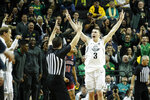 Oregon's Payton Pritchard (3) celebrates a three-point basket that put the team ahead of Arizona during the second half of an NCAA college basketball game Thursday, Jan. 9, 2020, in Eugene, Ore. (AP Photo/Thomas Boyd)