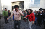 U.S. citizen Paul Ceglia does a dance typically performed by people released from jail in Quito, Ecuador, Tuesday, June 11, 2019. Ecuador released the New York man and turned down an extradition request from the United States, where he was arrested after falsely claiming he was owed half-ownership of Facebook. (AP Photo/Soledad Nunez)