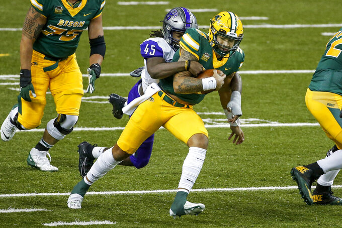 Central Arkansas linebacker Dre Matthews (45) tackles North Dakota State quarterback Trey Lance (5) on a run in the first quarter of an NCAA college football game Saturday, Oct. 3, 2020, in Fargo, N.D. North Dakota State won 39-28. (AP Photo/Bruce Kluckhohn)
