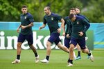 Italy's Giorgio Chiellini, center, runs during a training session at Tottenham Hotspur training ground in London, Saturday, July 10, 2021 ahead of the Euro 2020 soccer championship final match against England at Wembley Stadium on Sunday. (AP Photo/Frank Augstein)