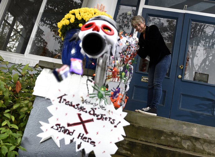 Carol McCarthy sends candy down the candy chute that she will use to give out treats to socially-distant trick-or-treaters on Halloween, Monday, Oct. 26, 2020, in Palmyra, N.J. (AP Photo/Michael Perez)