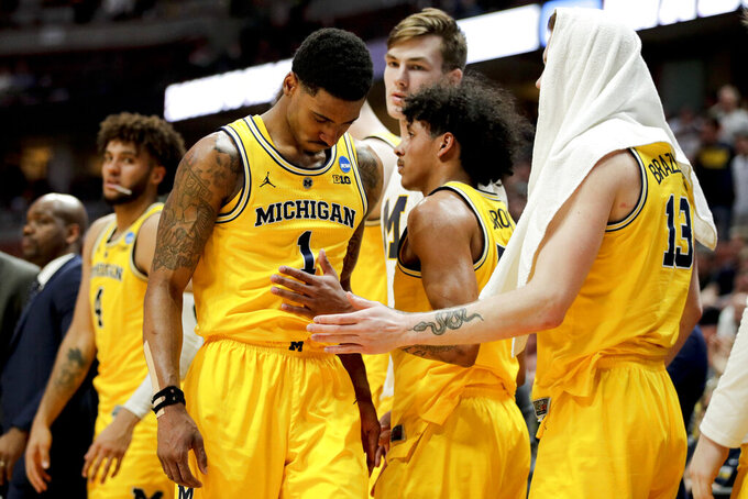 Michigan guard Charles Matthews leaves the court during the team's loss to Texas Tech in an NCAA men's college basketball tournament West Region semifinal Thursday, March 28, 2019, in Anaheim, Calif. (AP Photo/Jae C. Hong)