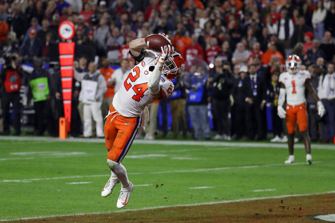 Clemson safety Nolan Turner (24) intercepts an Ohio State pass during the final minute of the Fiesta Bowl NCAA college football playoff semifinal Saturday, Dec. 28, 2019, in Glendale, Ariz.(AP Photo/Rick Scuteri)