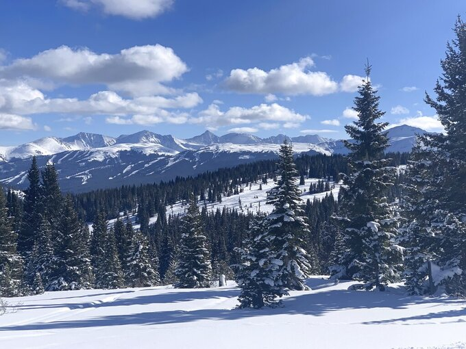 In this Jan. 1, 2021 photo, the Vail Pass Recreation Area covers 85 square miles of the White River National Forest, in Colorado, offering exceptional skiing, snowshoeing and snowmobiling. The Copper Mountain can be seen, looking southeast., here. Colorado's ski areas send about $25 million a year in fees to the federal treasury in exchange for being on federal land, and only a small fraction returns to those forests for management. (John Meyer/The Denver Post via AP)