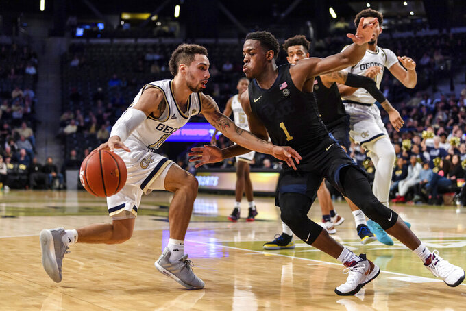 Georgia Tech guard Jose Alvarado (10) drives to the basket as Pittsburgh guard Xavier Johnson (1) defends during the first half of an NCAA college basketball game Wednesday, Feb. 20, 2019, in Atlanta. (AP Photo/Danny Karnik)