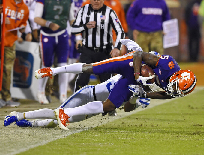 Clemson's Tee Higgins is tackled out of bounds by Duke's Leonard Johnson during the first half of an NCAA college football game Saturday, Nov. 17, 2018, in Clemson, S.C. (AP Photo/Richard Shiro)