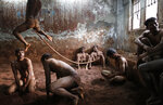"""In this photo provided by Reuters, wrestlers practice as others rest at a traditional Indian wrestling center called """"Akhaara"""" in Mumbai, India, on March 4, 2014. Kushti (mud wrestling) is a traditional sport in India but more and more young athletes are now training to wrestle on mats instead of mud to gain access to top international competitions like the Olympic Games or the Commonwealth Games. (Danish Siddiqui/Reuters via AP)"""