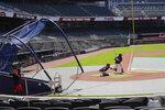 Atlanta Braves' Marcell Ozuna bats during baseball team practice at Truist Park on Friday, July 3, 2020, in Atlanta. (AP Photo/Brynn Anderson)