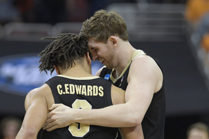 Purdue's Ryan Cline, right and Carsen Edwards (3) celebrate during overtime of a men's NCAA Tournament college basketball South Regional semifinal game against Tennessee Thursday, March 28, 2019, in Louisville, Ky. Purdue won 99-94. (AP Photo/Timothy D. Easley)