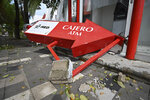 A bank cash machine lays on the ground after the passing of Hurricane Pamela in Mazatlan, Mexico, Wednesday, Oct. 13, 2021. Hurricane Pamela made landfall on Mexico's Pacific coast just north of Mazatlan on Wednesday, bringing high winds and rain to the port city. (AP Photo/Roberto Echeagaray)