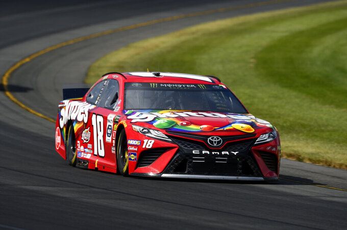 Kyle Busch drives through Turn 3 during a NASCAR Cup Series auto race, Sunday, July 28, 2019, in Long Pond, Pa. (AP Photo/Derik Hamilton)