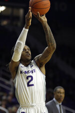 Kansas State's Cartier Diarra shoots a three-point shot during the first half of an NCAA college basketball game against Alabama State Wednesday, Dec. 11, 2019, in Manhattan, Kan. (AP Photo/Charlie Riedel)