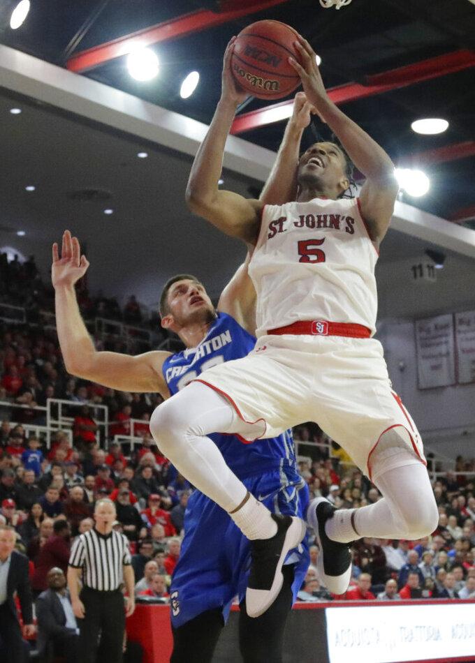 St. John's Justin Simon (5) drives past Creighton's Martin Krampelj during the second half of an NCAA college basketball game Wednesday, Jan. 16, 2019, in New York. St. John's won 81-66. (AP Photo/Frank Franklin II)