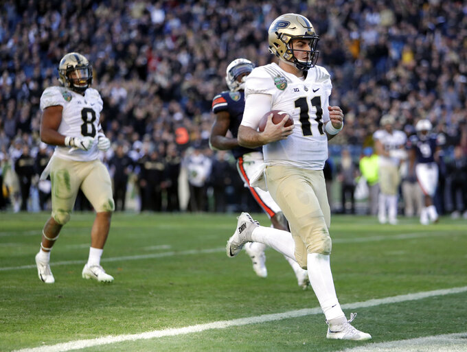 Purdue quarterback David Blough (11) scores a touchdown on a 22-yard run against Auburn in the second half of the Music City Bowl NCAA college football game Friday, Dec. 28, 2018, in Nashville, Tenn. (AP Photo/Mark Humphrey)