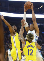 Charlotte Hornets forward PJ Washington, right, shoots against Golden State Warriors guard Alec Burks, left, and guard Ky Bowman (12) during the first half of an NBA basketball game in San Francisco, Saturday, Nov. 2, 2019. (AP Photo/Jeff Chiu)