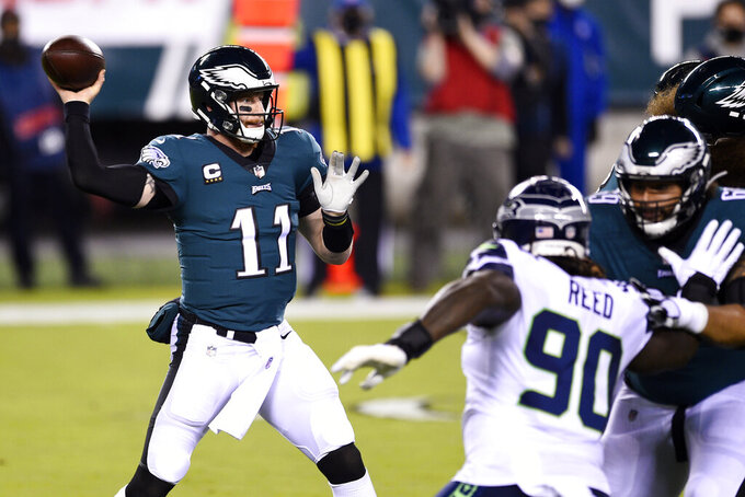 Philadelphia Eagles' Carson Wentz passes during the first half of an NFL football game against the Seattle Seahawks, Monday, Nov. 30, 2020, in Philadelphia. (AP Photo/Derik Hamilton)