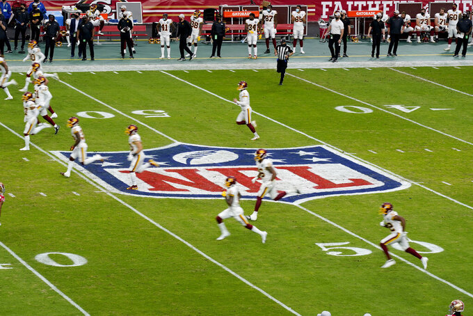 The Washington Football Team begin play during the first half of an NFL football game against the San Francisco 49ers, Sunday, Dec. 13, 2020, in Glendale, Ariz. (AP Photo/Ross D. Franklin)