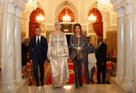 Wearing Moroccan caftans, Ivanka Trump, the daughter and senior adviser to President Donald Trump, and Princess Lalla Meryem of Morocco, right, Thursday, Nov. 7, 2019, walk to greet guests before a dinner at the Royal Guest House in Rabat, Morocco. At left of Trump is Sean Cairncross, CEO of the Millennium Challenge Corporation. (AP Photo/Jacquelyn Martin)