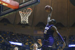 TCU forward Kouat Noi (12) ducks on a fast break during the first half of an NCAA college basketball game against West Virginia Monday, Feb. 12, 2018, in Morgantown, W.Va. (AP Photo/Raymond Thompson)