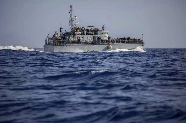 FILE - This June 24, 2018 file photo, released by the Libyan Coast Guard, shows migrants on a ship intercepted offshore near the town of Gohneima, east of the capital, Tripoli, Libya. On Wednesday, Feb. 12, 2020, Human Rights Watch, a leading rights group, said that Italy's renewed support for the Libyan coast guard is putting migrants at risk who are returned to squalid detention centers in the North African country. The group urged that Italy suspend all funding and training for the coast guard until Libya commits to shutting down militant-run detention centers in the country. (Libyan Coast Guard via AP, File)