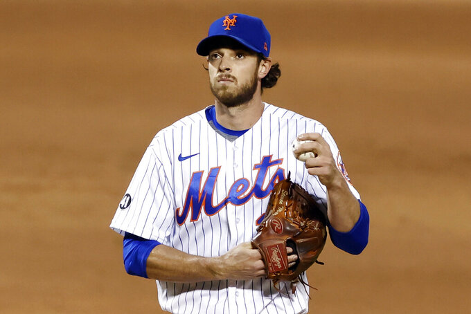 New York Mets pitcher Steven Matz reacts during the second inning of a baseball game against the Atlanta Braves, Friday, Sept. 18, 2020, in New York. (AP Photo/Adam Hunger)