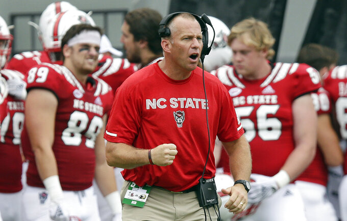 FILE - In this Saturday, Oct. 6, 2018, file photo, North Carolina State head coach Dave Doeren reacts during the second half an NCAA college football game against Boston College, in Raleigh, N.C. Doeren says receiver Kelvin Harmon's strength and timing with quarterback Ryan Finley have helped him routinely make tough catches. (AP Photo/Gerry Broome, File)