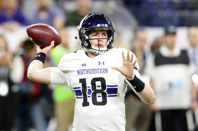Northwestern quarterback Clayton Thorson (18) throws during the first half of the Big Ten championship NCAA college football game against Ohio State, Saturday, Dec. 1, 2018, in Indianapolis. (AP Photo/AJ Mast)