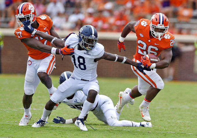 Clemson's Adam Choice (26) breaks away from Georgia Southern's Justin Birdsong (18) with blocking help from Justin Mascoll during the second half of an NCAA college football game Saturday, Sept. 15, 2018, in Clemson, S.C. Clemson won 38-7. (AP Photo/Richard Shiro)