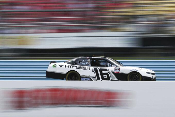 AJ Allmendinger passes the grandstand in the final stage of the NASCAR Xfinity Series auto race at Watkins Glen International in Watkins Glen, N.Y., on Saturday, Aug. 7, 2021. (AP Photo/Joshua Bessex)
