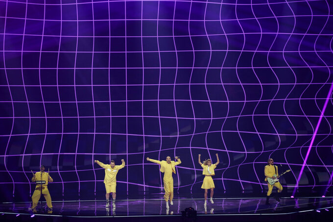Musical group The Roop from Lithuania perform at the first semi-final of the Eurovision Song Contest at Ahoy arena in Rotterdam, Netherlands, Tuesday, May 18, 2021. (AP Photo/Peter Dejong)
