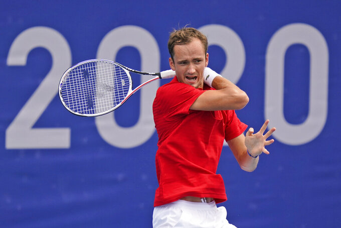 Daniil Medvedev, of the Russia Olympics Committee, plays Sumit Nagal, of India, during the second round of the tennis competition at the 2020 Summer Olympics, Monday, July 26, 2021, in Tokyo, Japan. (AP Photo/Seth Wenig)