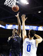 Washington guard Jaylen Nowell, left, shoots over UCLA forward Alex Olesinski during the first half of an NCAA college basketball game in Los Angeles, Sunday, Dec. 31, 2017. (AP Photo/Ringo H.W. Chiu)