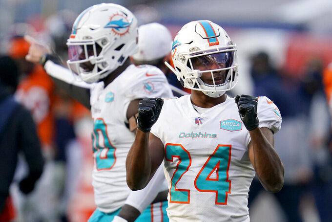 Miami Dolphins cornerback Byron Jones (24) celebrates a turnover by the Denver Broncos during the second half of an NFL football game, Sunday, Nov. 22, 2020, in Denver. (AP Photo/David Zalubowski)