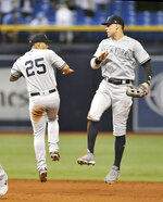 New York Yankees' Gleyber Torres (25) and Aaron Judge celebrate a 4-1 win over the Tampa Bay Rays during a baseball game Monday, Sept. 24, 2018, in St. Petersburg, Fla. (AP Photo/Steve Nesius)