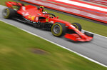In this image taken with a slow shutter speed, Ferrari driver Charles Leclerc of Monaco steers his car during the first practice session at the Red Bull Ring racetrack in Spielberg, Austria, Friday, July 3, 2020. The Austrian Formula One Grand Prix will be held on Sunday. (Joe Klamar/Pool via AP)