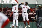 Boston Red Sox's Christian Vazquez, left, celebrates his three-run home run that also drove in Xander Bogaerts, right, during the sixth inning of a baseball game against the Baltimore Orioles, Tuesday, Sept. 22, 2020, in Boston. (AP Photo/Michael Dwyer)