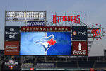 The Toronto Blue Jays' logo is displayed on the scoreboard during the middle of the eighth inning of the team's baseball game against the Washington Nationals, Wednesday, July 29, 2020, in Washington. The Blue Jays are the home team in the game. (AP Photo/Nick Wass)