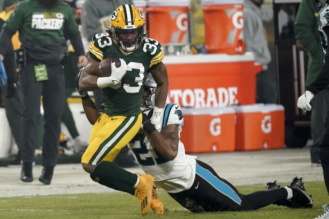 Carolina Panthers' Jeremy Chinn stops Green Bay Packers' Aaron Jones- on a long run during the first half of an NFL football game Saturday, Dec. 19, 2020, in Green Bay, Wis. (AP Photo/Morry Gash)