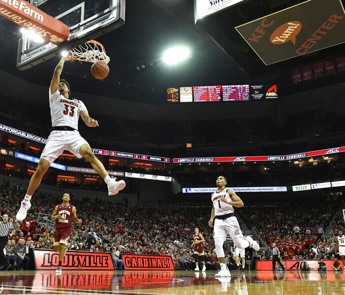 Louisville forward Jordan Nwora (33) dunks for two of his game high 32 points during the second half of an NCAA college basketball game against Boston College in Louisville, Ky., Wednesday, Jan. 16, 2019. Louisville won 80-70. (AP Photo/Timothy D. Easley)