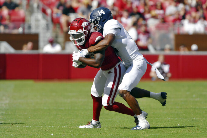 Arkansas receiver De'Vion Warren (10) is tackled by Georgia Southern corner back Darrell Baker Jr. (14) during the first half of an NCAA college football game Saturday, Sept. 18, 2021, in Fayetteville, Ark. (AP Photo/Michael Woods)