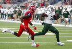 Colorado State running back Marcus McElroy runs past Fresno State's Chris Gaston for a touchdown during the first half of an NCAA college football game in Fresno, Calif., Saturday, Oct. 26 2019. (AP Photo/Gary Kazanjian)