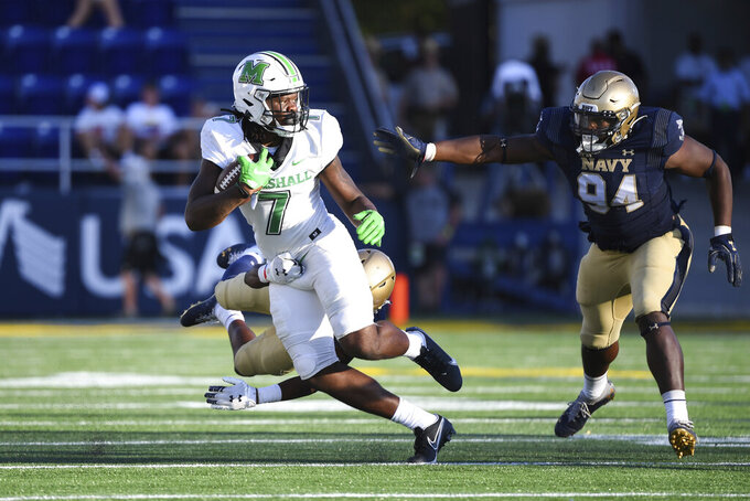 Marshall wide receiver Corey Gammage (7) runs the ball against Navy defensive tackle J'arius Warren (94) during the second half of an NCAA college football game, Saturday, Sept. 4, 2021, Annapolis, Md. (AP Photo/Terrance Williams)