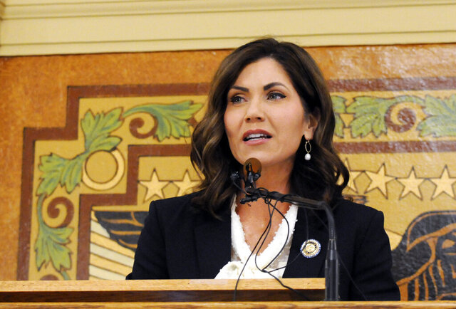 FILE - In this Jan. 8, 2019 file photo, South Dakota Gov. Kristi Noem gives her first State of the State address in Pierre, S.D. While many other governor's have broken from President Donald Trump on stay-at-home orders to curb the spread of coronavirus or when to restart economic activity, Noem has tracked close to the president.  (AP Photo/James Nord, File)