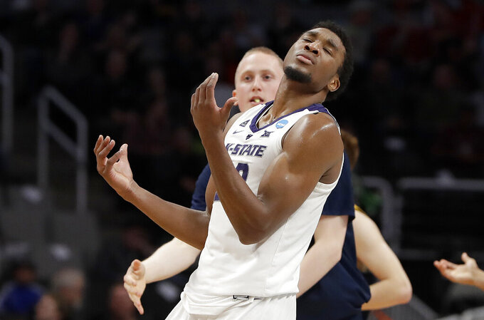 Kansas State forward Xavier Sneed reacts after being called for a foul against UC Irvine during the second half of a first round men's college basketball game in the NCAA Tournament, Friday, March 22, 2019, in San Jose, Calif. (AP Photo/Chris Carlson)