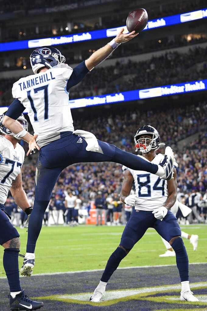 Tennessee Titans quarterback Ryan Tannehill (17) celebrates his touchdown against the Baltimore Ravens during the second half of an NFL divisional playoff football game, Saturday, Jan. 11, 2020, in Baltimore. (AP Photo/Nick Wass)