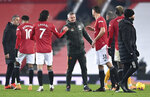 Manchester United's manager Ole Gunnar Solskjaer, center, greets his players after the English Premier League soccer match between Manchester Utd and Wolverhampton Wanderers at Old Trafford stadium in Manchester, England, Tuesday,Dec. 29, 2020. (Laurence Griffiths, Pool via AP)
