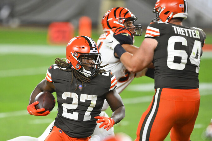 Cleveland Browns running back Kareem Hunt (27) rushes for a 1-yard touchdown during the second half of the team's NFL football game against the Cincinnati Bengals, Thursday, Sept. 17, 2020, in Cleveland. The Browns won 35-30. (AP Photo/David Richard)