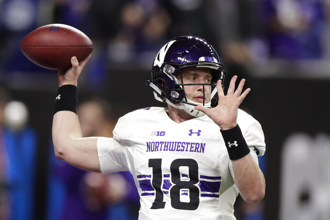 Northwestern quarterback Clayton Thorson warms up for the Big Ten championship NCAA college football game between Northwestern and Ohio State, Saturday, Dec. 1, 2018, in Indianapolis. (AP Photo/Michael Conroy)